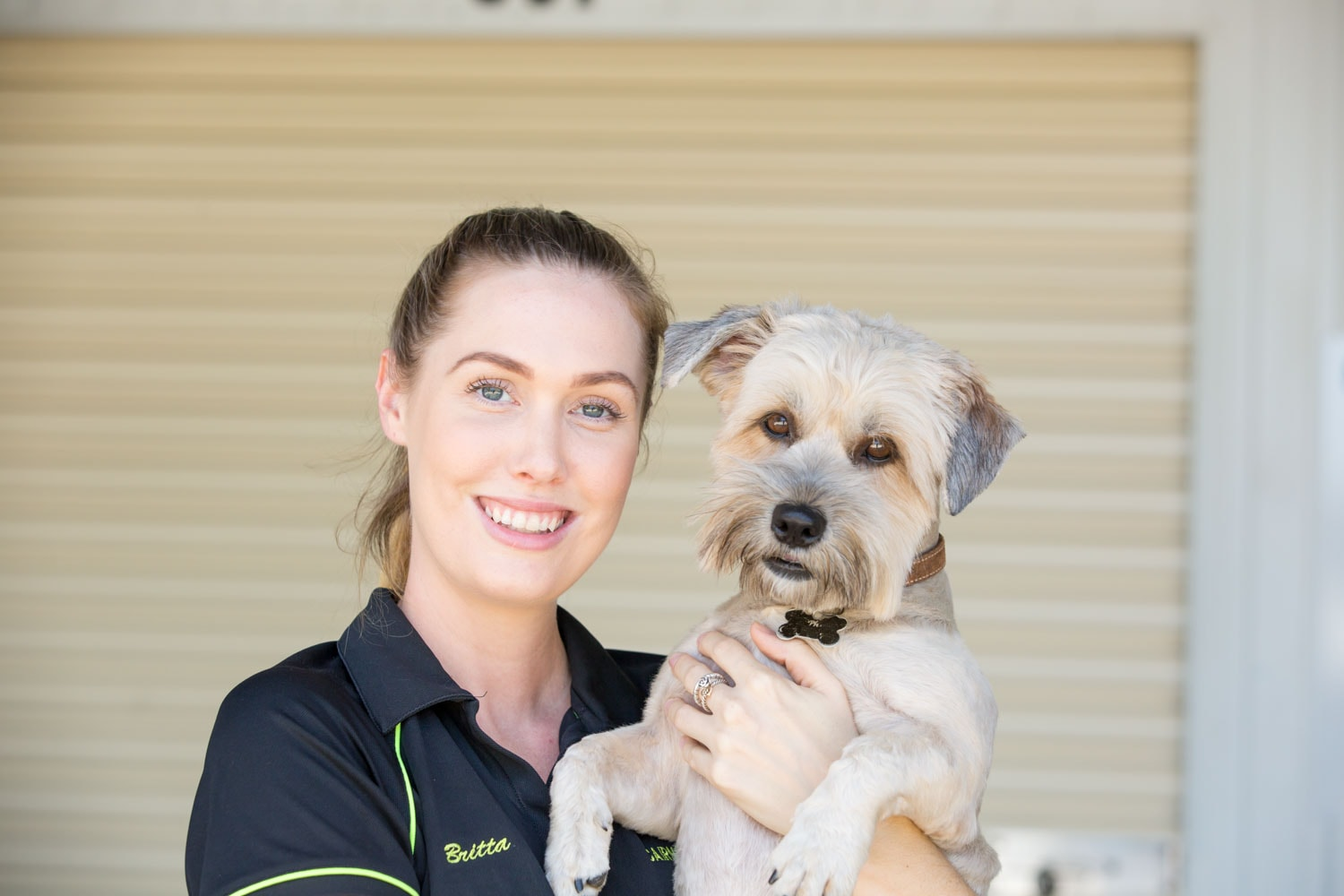 Staff member holding dog at Cairns Beaches Storage in Cairns