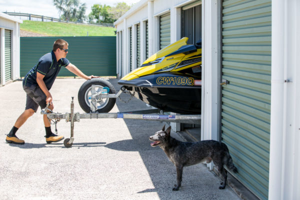 jetski being pushed into storage unit at cairns beaches storage