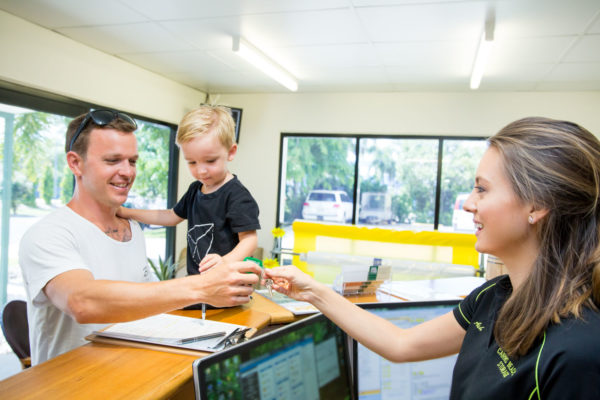 Staff member handing key to customer at Cairns Beaches Storage