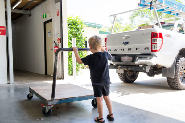 kid pushing trolley at Cairns Beaches Storage